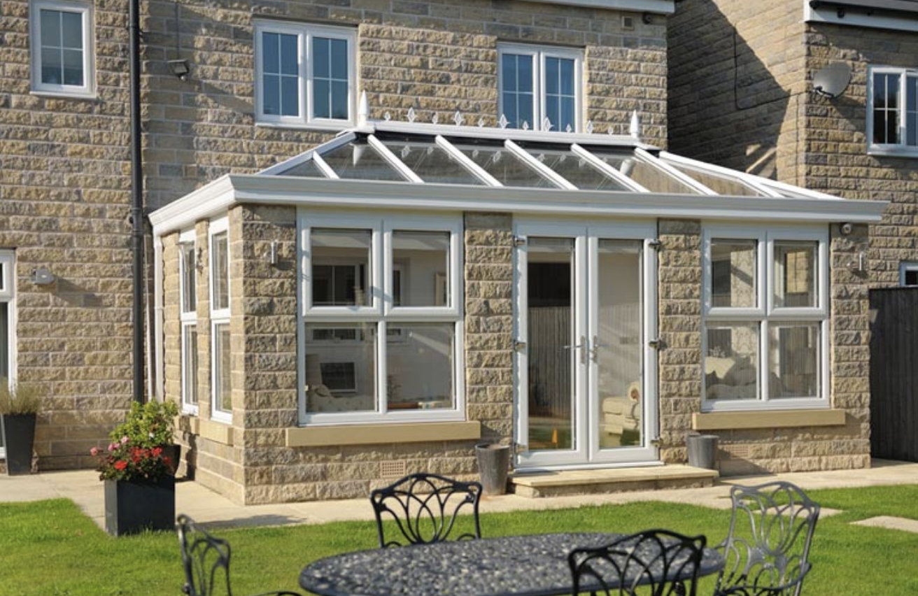 Stone conservatory outside a house