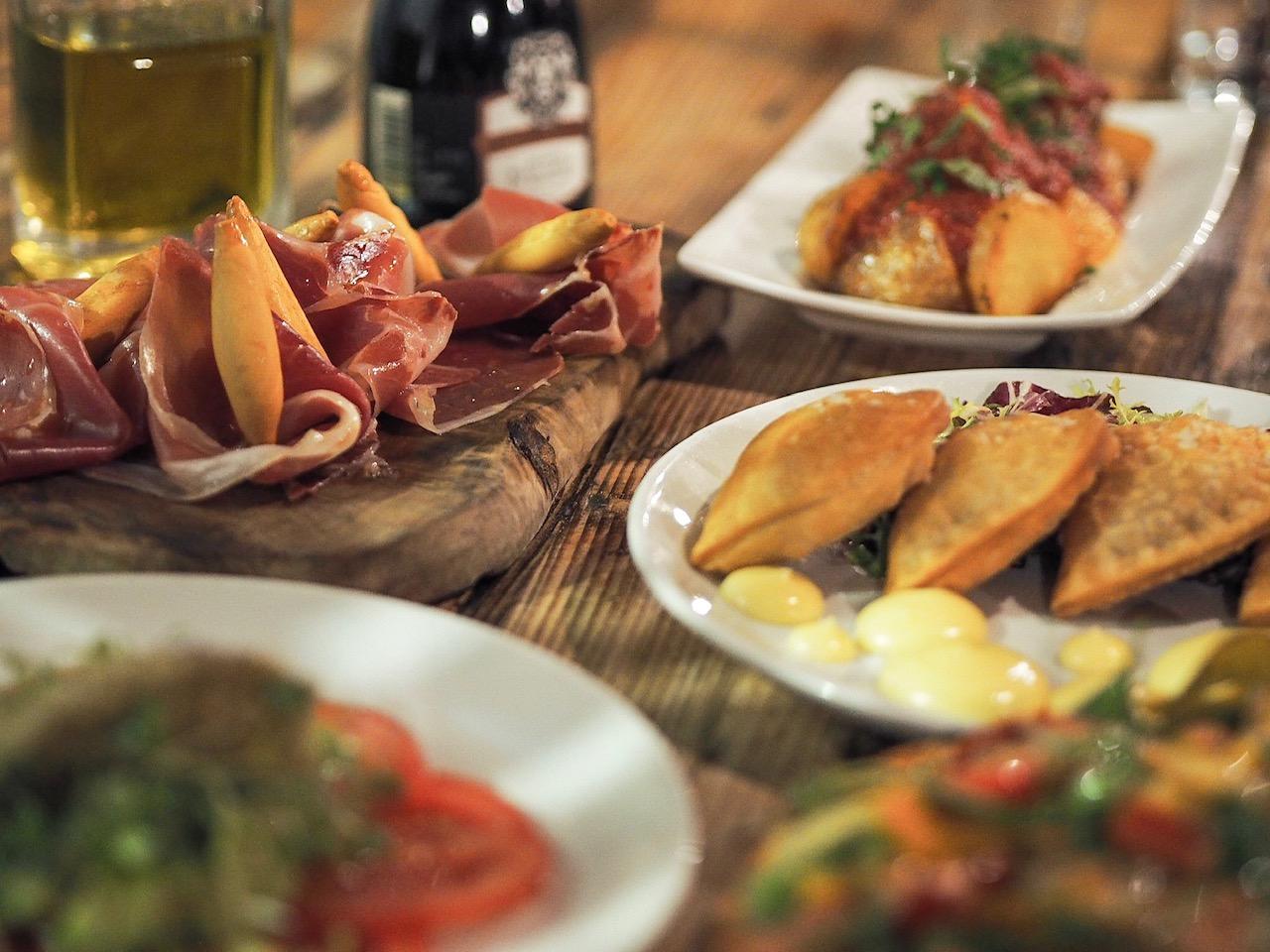 Serrano ham, tuna pastries and patatas bravas at Evuna Manchester.